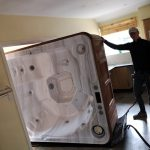 Hot Tub Removal Through a House - The Hot Tub Mover