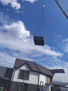 Hot Tub being lifted over a house - The Hot Tub Mover