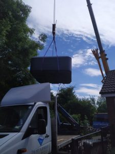 Hot tub being lifted off a truck - The Hot Tub Mover